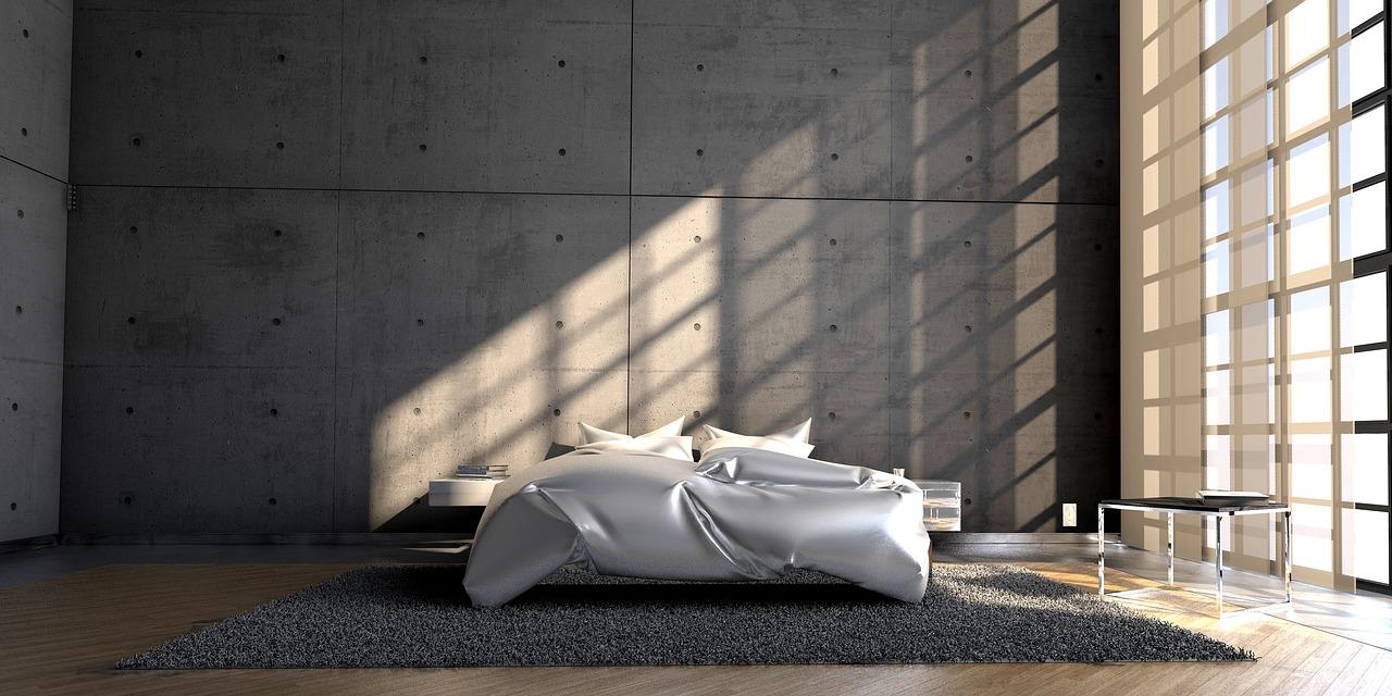 nowoczesna minimalstyczna sypialnia z białym łóżkiem